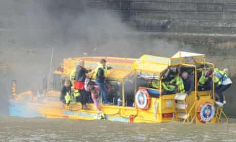 A Duck Tour boat catches fire on the River Thames in London