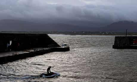 A jet-ski prepares to bring surfers out to sea at Mullaghmore, County Sligo, Ireland