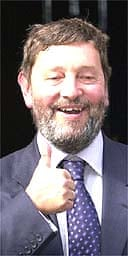 David Blunkett gives the thumbs up as he leaves Downing Street after being made home secretary. Photo: Toby Melville, PA