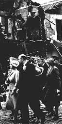 The Queen Mother and King George VI tour bombed areas of south London in 1940