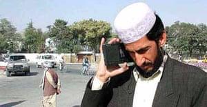 Afghan man listens to radio