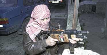 Masked Palestinian gunman in the West Bank city of Nablus