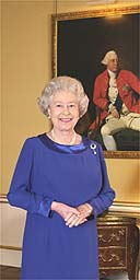 Queen Elizabeth II stands in the 18th century room at Buckingham Palace