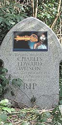 A gravestone with advertising billboard