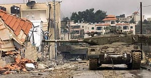 An Israeli tank outside Yasser Arafat's compound in the West Bank city of Ramallah