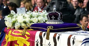 The coffin of Queen Elizabeth, the Queen Mother with her Crown and a wreath from her daughter the Queen