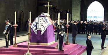 Prince Charles (left), Prince Andrew (second left), Prince Edward (right) and Viscount Linley stand vigil at the coffin of the Queen Mother