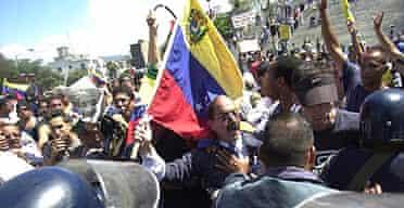 Former president of Petroleos de Venezuela, General Guicaipuro Lameda, holding the national flag