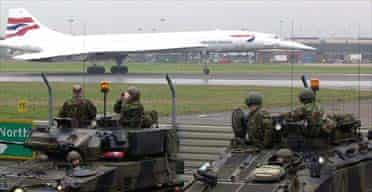 British troops at Heathrow airport as Concorde departs for New York
