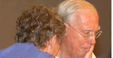 Derek Bond, with wife Audrey, after his release