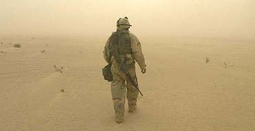 Cpl Bryan Beard on duty in a sandstorm near the army 1st Battalion, 3rd Infantry Division in southern Iraq