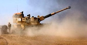 A British Army AS90 gun fires at Iraqi positions