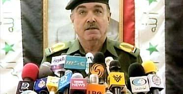 Iraqi health minister Umeed Madhat Mubarak speaks to reporters