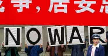 Peking University students stage an anti-war protest in Beijing