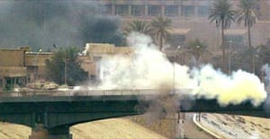A US tank fires from a bridge crossing the Tigris river near the Iraqi Ministry of Information in central Baghdad