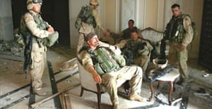 US soldiers of the 3rd Battalion, 7th Infantry Regiment, including Staff Sergeant Chad Touchett, centre, after seizing the presidential palace in Baghdad