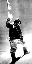 Sherpa Tenzing Norgay stands on the summit of Everest