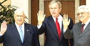 US president George Bush (centre) with Israeli prime minister Ariel Sharon (left) and Palestinian PM Mahmoud Abbas at Beit al Bahar Palace in the Jordanian Red sea resort of Aqaba