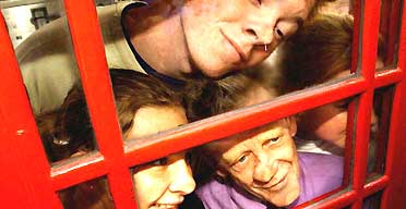 Members of the Kabosh theatre company, joined by volunteers, squeeze into a phone box on Edinburgh¿s Royal Mile