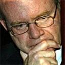 Martin McGuinness listens to Tony Blair