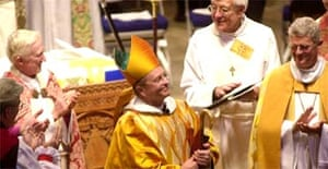 Gene Robinson smiles as he is introduced as bishop in Durham, New Hampshire