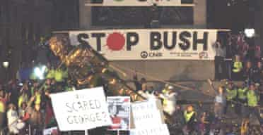 Protesters in London topple an effigy of George Bush
