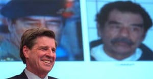 Paul Bremer, the senior US administrator in Iraq, smiles after announcing that former Iraqi leader Saddam Hussein was captured, during a news conference in Baghdad