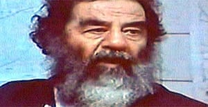Video image of captured former Iraqi leader Saddam Hussein displayed at a news conference in Baghdad