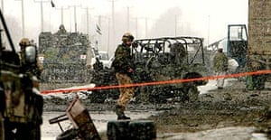 A soldier guards the scene of a suicide bomb attack against British soldiers in Kabul