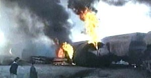 A train carrying industrial chemicals burns after it exploded outside the Iranian town of Neyshapur, Iran, in this image from television
