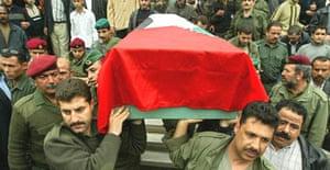 Palestinian security officers carry the coffin of YasserÀs ArafatÀs former close adviser Khalil al-Zaben after gunmen shot him dead in Gaza city