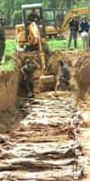 Excavation of a mass grave near Vukovar, Croatia