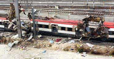 Destroyed railway carriages sit on the tracks after a bomb exploded in the Atocha railway station in Madrid