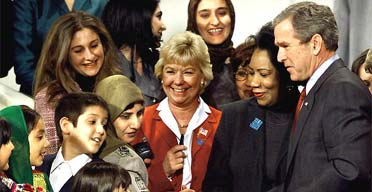 George Bush after signing law to help Afghan women at the National Museum of Women in the Arts in Washington, in December 2001