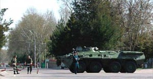 Soldiers block a road leading out of the Uzbek capital Tashkent
