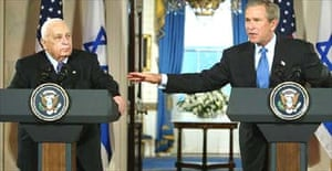 George Bush points towards the Israeli prime minister, Ariel Sharon, during a joint press conference at the White House to announce America's support for Israel's policy shift on Palestine