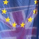 A European Union flag flies next to a Union Jack flag