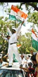 Congress Party supporters celebrate in front of the party office in New Delhi