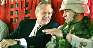 US defence secretary Donald Rumsfeld, and General Ricardo Sanchez, commander of the coalition forces in Iraq, during their flight from Kuwait City to Baghdad