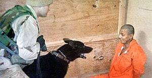 Picture published in the Washington Post showing abuse of an Iraqi prisoner at Abu Ghraib prison