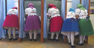Hungarian women in traditional costume vote at a polling station near Budapest in the European parliamentary elections. <B>Photograph: Laszlo Balogh/Reuters</B>