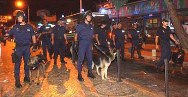 Portugese riot police block off a street after skirmishes with soccer fans in Albufeira, Portugal