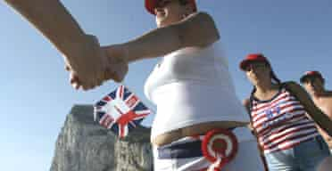 People form a human chain in Gibraltar to celebrate the Rock's 300th anniversary as a British dependency. Photograph: Jose Luis Roca/AFP/Getty Images