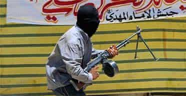 An Iraqi militiaman during fighting in Najaf