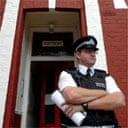 A police officer guards a house in north London after an anti-terror raid
