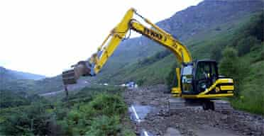 Clear-up gets under way after two landslides blocked a major road in the Lochearnhead area, Scotland
