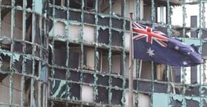 An Australian flag flies near a damaged building in Jakarta following an explosion outside the Australian embassy. Photograph: Achmad Ibrahim/AP