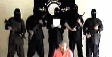 Image taken from Islamist website showing American hostage Eugene Armstrong, moments before he was beheaded