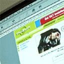 Man downloading music files from Kazaa.com