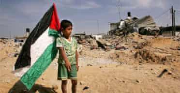 A Palestinian boy among the demolished homes of Jabaliya refugee camp